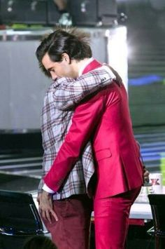 Mika and Elio um.... hugging X Factor