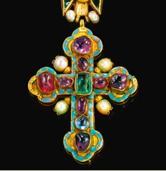 Jeweled and Enameled Gold Cross Necklace, from Georgia, Late 17th Century Made with rubies, sapphires, enamel, pearls and gold. This once belonged to Princess Sophia (Sopio) Nakashidze, née Dadiani (b. circa 1861). Artists in Georgia were among the first in the ancient world to process metals. Among the archaeological finds of the Trialeti and Bedeni mounds of southern Georgia are fine gold pins, elaborately chased, dating from the second half of the 3rd millennium BC; enamel was used in…