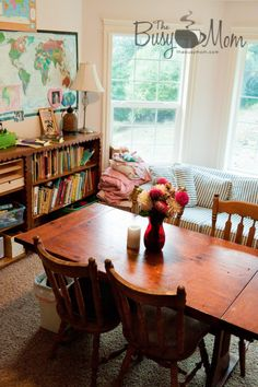 Love the window seat and couch paired with the school table and books.