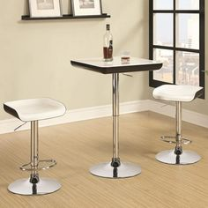 Black and White Bar Table / Bar Stools with adjustable height feature.  http://farbelowretail.net/shop/bar-table-set/