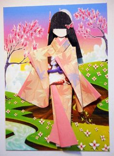 ATC with hand-folded Japanese origami paper doll. Traded at AFA.  Materials: Background (design print from 123RF); kimono and kimono lining (origami paper); obi (wrinkly handmade paper); viscose cord on obi; hair decor (nail art sticker).