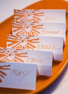Graphic escort cards #weddings #orange #escortcards