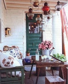 back patio idea - I enjoy these lanterns from the ceiling and the rustic table and bench.