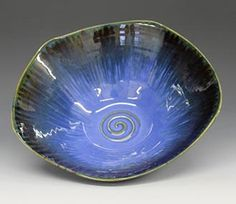 Bowl dipped in PC-23 Indigo Float with a thick PC-53 Ancient Jasper trailed around the rim