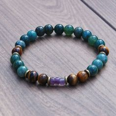 We've created this bracelet to help attract and maintain prosperity in your life. Moss Agate is one of the most important gemstones in regards to creativity and prosperity. Moss agate helps people to