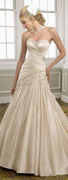Pale cream satin wedding gown