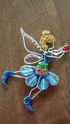 Wire wrapped beaded garden fairy sun catcher with ladybug.