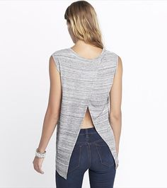 This grey open back tank looks fabulous paired with skinny jeans and long pendant necklace.