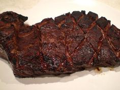 Grilled Balsamic London Broil.  Marinade for at LEAST 24 hours, I use Flank steak (London broil; not round steak).  Broil 8-10 minutes per side in oven six inches from the element or on grill.  FANTASTIC!
