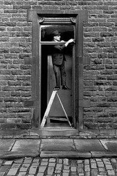 GB. England. West Yorkshire. Hebden Bridge. Tom Greenwood cleaning. 1976. Photo by Martin Parr.