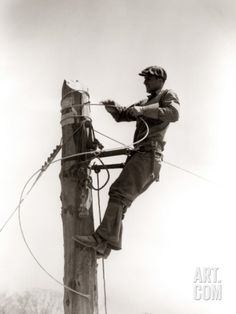 H. Armstrong Roberts - Man Worker, Working Atop Utility Pole, Installing Electric Wires For Power Utilities Photographic Print