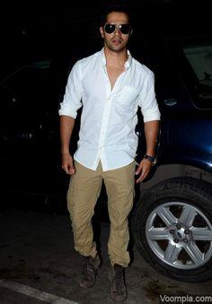 Varun Dhawan's casual style - cargos, white shirt and dark sunglasses. via Voompla.com