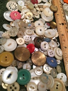 This is a collection of a mixed lot of VINTAGE buttons, mostly in shades of white. They vary a great deal in size from tiny buttons to large 1.5 inch (3.5 cm) buttons. See the pictures with the ruler.  You will receive 50 buttons to sew or create with. Ready to ship from a NON-SMOKING HOME within 2 days of payment. I will gladly combine shipping costs on multiple orders. So check out my shop, you never know what treasures you may find! https://www.etsy.com/shop/HookedonBle...