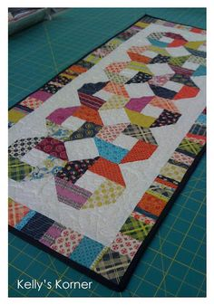 Kelly's Korner: Chicopee Good idea for kids scrappy quilt too. Not Hope Valley fabric but Denyse Schmidt fabric so close enough and it could be made using Hope Valley. Patchwork Table Runner, Table Runner And Placemats, Table Runner Pattern, Quilted Table Runners, Lap Quilts, Small Quilts, Mini Quilts, Scrappy Quilts, Quilting Fabric