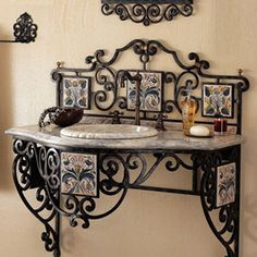 """Maitland-Smith - Iron Scroll Vanity - Not your same old ordinary vanity, this beautiful wrought iron scroll vanity adds an old world feel and elegance to the bath. Ceramic tiles are handpainted. Vanity has a marble top and sink is included, 38""""H x 37""""W x 22""""D."""