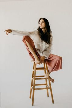Woman Model Posing on A Stool in Culottes and a Raincoat by Rachel Gulotta Photo. - - Woman Model Posing on A Stool in Culottes and a Raincoat by Rachel Gulotta Photography for Stocksy United Source by vkcconsultants