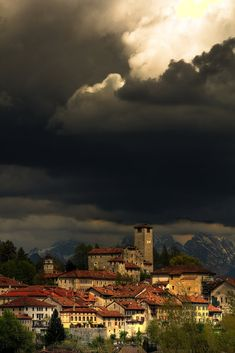 Feltre, Italy. It is very difficult to describe the notion of a storm approaching an Italian town. It's Nature threatening Civilization. History defeated by Energy.