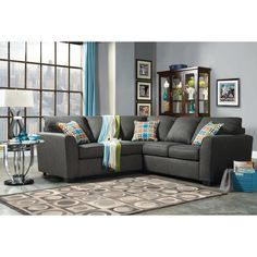 Set it anywhere the Playan fully furnished sectional offers a soft gray upholstery, padded with fun filled comfort. Colorful pillow accents make any living space feel like spring, and this piece is greatly supported with modern tapered elevation.