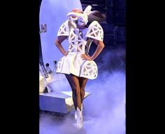 Lady Gaga took to the stage in an abstract white bunny costume, complete with exaggerated shoulder and hip details, white booties, and an abstract mask finished with pointed rabbit ears.