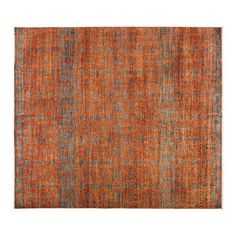 Found it at Wayfair - Eclectic Hand-Knotted Orange Area Rug.  Strong blue background.