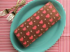 The cutest dessert on earth Learn step by step how to make a lovely heart patterned chocolate cake roll filled with white chocolate whipped ganache and...