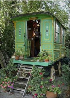 Gypsy wagon. I like the green with yellow trim and shutters. The straight rather than rounded sides would make more room inside