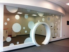 """Circles"" (round door, vinyl decorative white dots motive) ~ found at: http://solartechsigns.com"