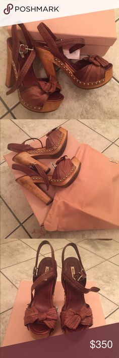 Miu Miu Leather Bow Platform Heels Adorable brown leather and wood, platform heels by Miu Miu.  They are a size 38 or US 8.  I've only worn them two times and still have the box and dust bag.  Excellent condition. Miu Miu Shoes Platforms