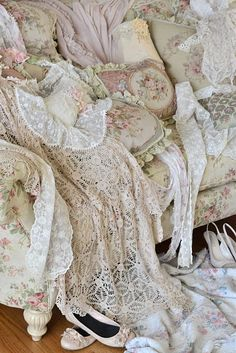 vintage linens and lace in soft hues of cream, white, and pink.