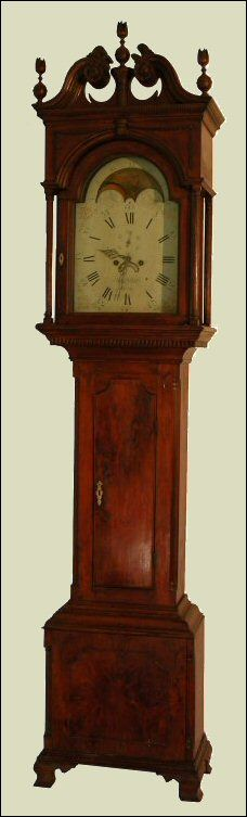 Carved tall clock, circa 1800, as found in many Civil War era homes.