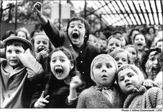 """Children watching the story of """"Saint George and the  Dragon,"""" at the puppet theater in the Tuileries, Paris, 1963 by Alfred Eisenstaedt"""