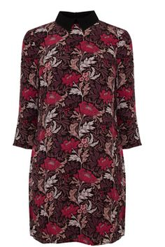 This 70s-inspired dress is constructed from a lightweight woven fabric and features a contrast peak collar, cropped sleeves, all-over floral print and hook fasting at nape. Length of dress, from shoulder seam to hem, 85cm approx. Height of model shown: 5ft 10 inches/178cm. Model wears: UK size 10.Fabric: Main: 100.0% Viscose. Contrast: 100.0% Viscose.Wash care: Machine WashProduct code: 02418599 Price: £48.00