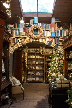 The book arches for Roger's Gardens Christmas display 2015 Book Arch, Rogers Gardens, Holiday Boutique, Visual Display, Interior Decorating, Interior Design, Garden Shop, Retail Space, Florida Home