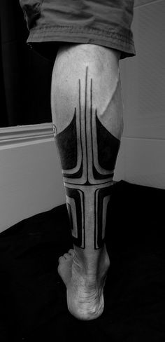 Black work and the contrast between heavy and thick, thin and straight. If the lines up the center of the calf had all stopped at one spot it wouldn't have worked.