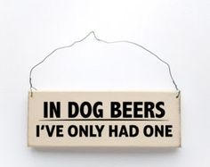"""Wooden Dog Beers sign - We've only had one, honest! Handmade from natural, ethically sourced wood in Marshfield, MA, USA.  Comes wired and ready to hang on walls, doors, peg racks, coat racks - anywhere!  Dimensions Length: 6-3/4"""" Height: 2-1/2"""" Depth: 3/4"""""""