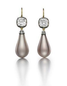 The Empress Eugénie Pearls set in a pair of earrings. Each pearl is suspended from a 3.01-carat old mine brilliant cut diamond. Photo courtesy of Siegelson Empress Eugenie Pearls