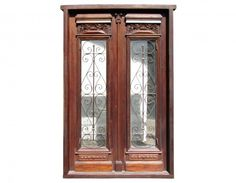 Antique double front door with wrought iron inserts.