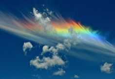 circumhorizontal arcs - this atmospheric phenomenon, otherwise known as a fire rainbow, is created when light from a sun that is at least 58 degrees above the horizon passes through the hexagonal ice crystals that form cirrus clouds which, because of quick cloud formation, have become horizontally aligned. Photo by Andy Cripe.