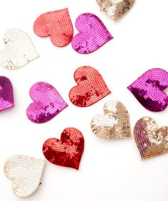 Sparkling mini hearts ($10 each) are great accessories to add to a belt, clutch, or even your bouquet