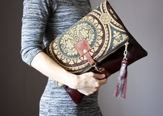 Large Leather fold over clutch, fold over bag, fold over purse, carpet bag,  tapestry fabric and mahogany leather clutch with leather tassel by VitalTemptation on Etsy https://www.etsy.com/uk/listing/291252847/large-leather-fold-over-clutch-fold-over