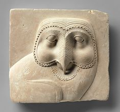 Relief plaque with face of an owl ~ Late Period-Ptolemaic Period BCE, Egypt. Limestone 4 x 4 x Metropolitan Museum of Art, New York City, New York Ancient Egyptian Art, Ancient History, Art History, European History, Ancient Aliens, Ancient Greece, American History, Objets Antiques, Art Antique