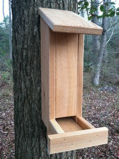 Hand crafted cedar squirrel feeder. Squirrel feeder made from 3/4' rough swan cedar that is strong and does not warp or bend over time. Cedar provides a natural looking feeder for squirrels. Cedar contains natural oils that repel insects and other bugs.