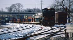 https://flic.kr/p/iBrpWA | Rockford, IL Traffic Jam | When the Soo Line was running the Davis Junction-Janesville segment through Rockford, IL things could show up at almost anytime. This was due to more customers--the WP&L coal trains for Beloit and the frame load out of Tower Automotive by the Rockford Airport that went up to GM in Janesville. Of course these days neither of these trains run, but as this view from December of 1994 shows, they were a good catch. This was Saturday, December…