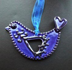 ceramic folk art  royal blue bird decoration  £6.00