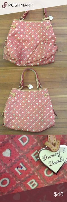 Dooney & Bourke bag - authentic Maurizia bag with twisted strap bag, great bag for the summer and fits everything for s beach day! Small blue mark on the back side of the bag but is hardly noticeable! Dooney & Bourke Bags Shoulder Bags