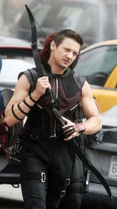 Jeremy Renner. Anyone else notice the tuft of red hair behind him? You can hardly see Scarlett behind him!