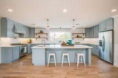 Traditional Kitchen with Flat panel cabinets, Kitchen island, Wainscoting, U-shaped, Hardwood floors, Farmhouse sink, Flush