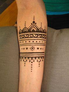 Gorgeous simple arm henna tattoo