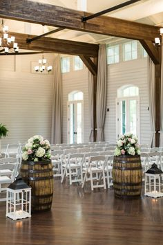 Wedding Ceremony Flowers on Wine Barrels | photography by http://www.rusticwhite.com/