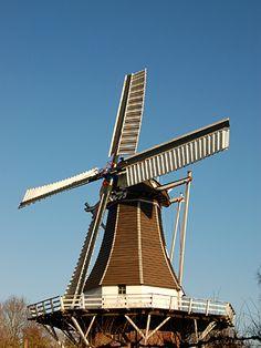 An old Dutch grain grinding windmill | Tilting Windmills ...